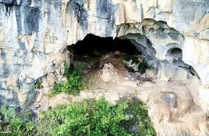 无人机拍到1个神秘山洞,洞口有个不明生物,你看这东西到底是啥
