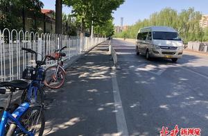 """北京""""停车乱象""""回访:龙潭公园加装护栏,多部门配合清理地锁"""